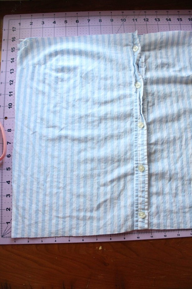 cutting out the fabric of an old shirt