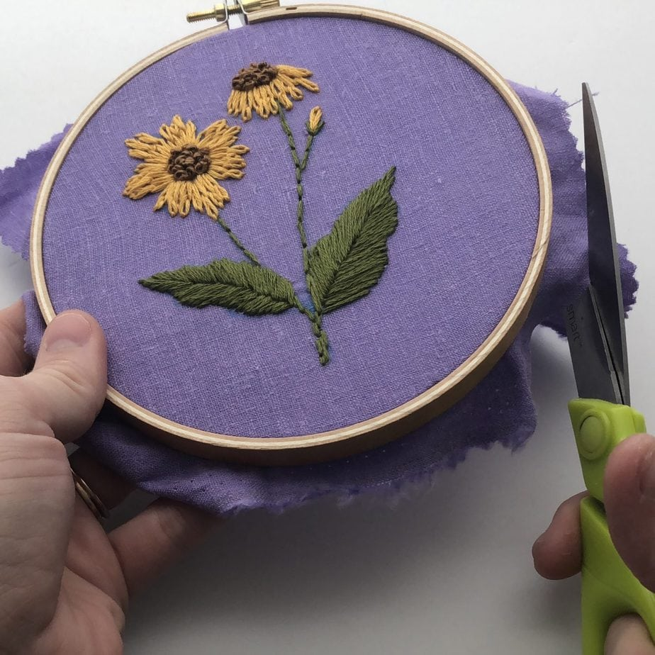 trimming extra fabric around embroidery hoop