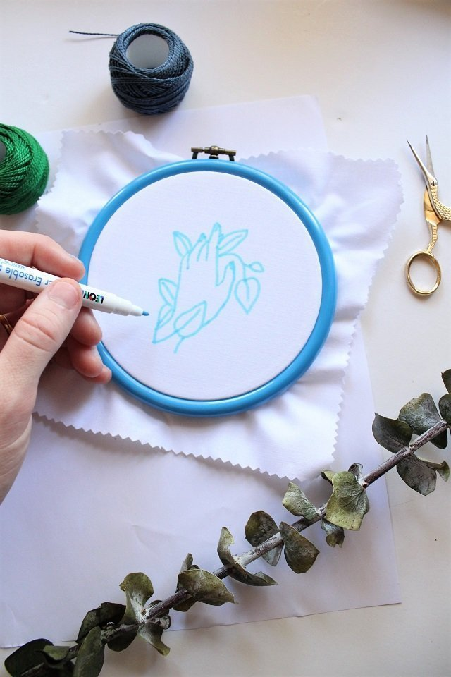 embroidery tools and materials - marker on fabric in an embroidery hoop