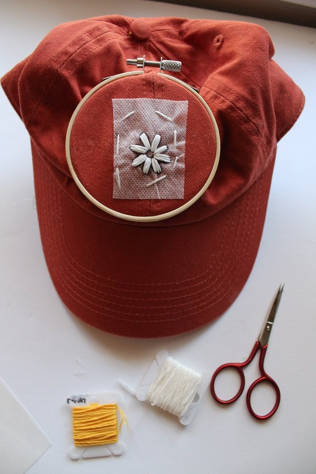 embroidering a flower