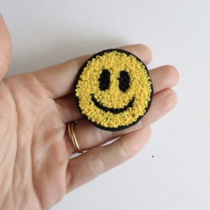 chenille patch of a smiley face