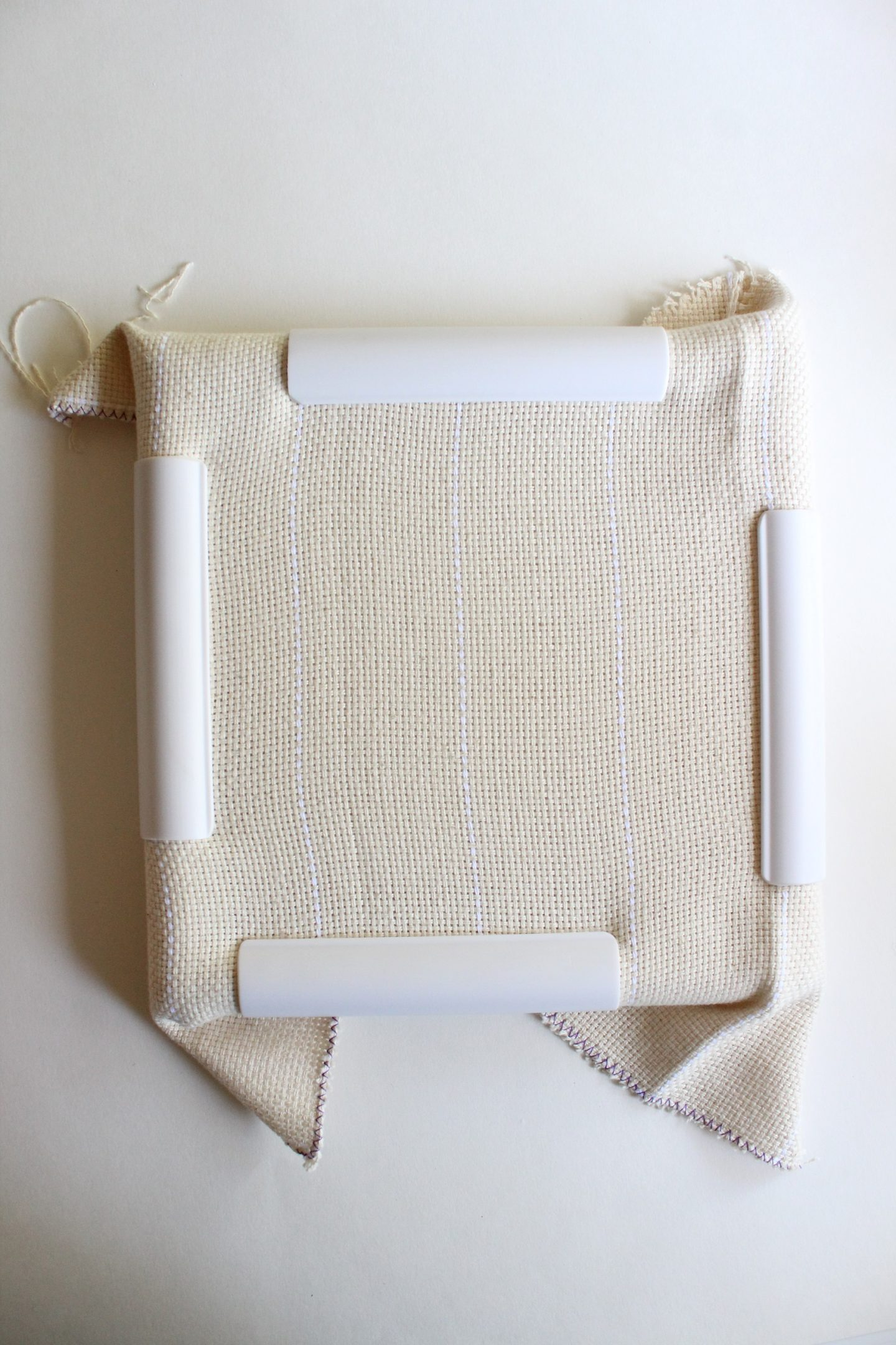 punch needle fabric in a frame
