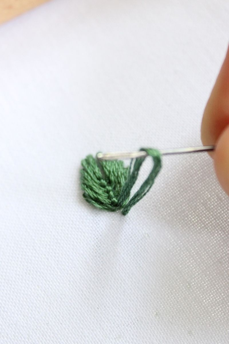 undoing embroidery stitches with a needle