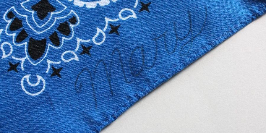 mark the cursive on the handkerchief