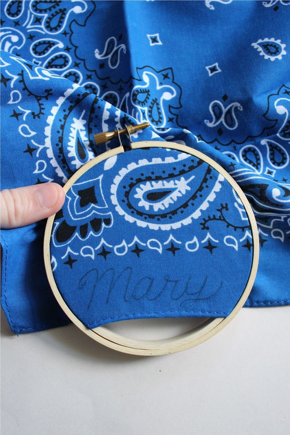 place handkerchief in the embroidery hoop
